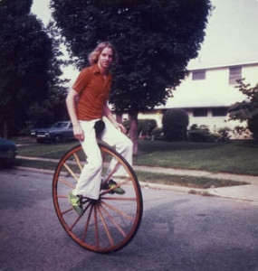 Kit Summers riding a unicycle with a very large wheel