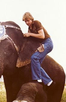 Kit Summers climbing on an elephant